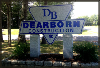 Granite sign in front of Dearborn Construction office