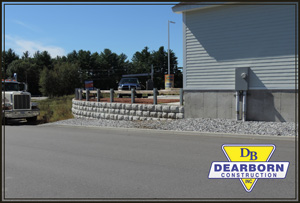 Retaining wall at gas station & car wash after construction - Sanford Maine